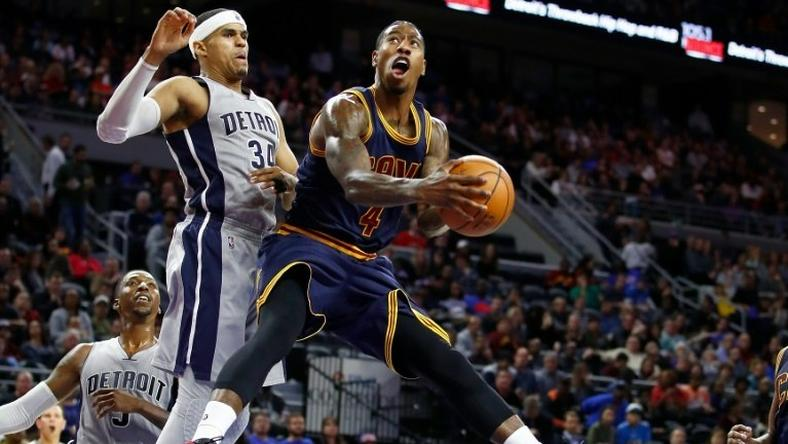 Iman Shumpert of the Cleveland Cavaliers looks to get a shot off around Tobias Harris of the Detroit Pistons during the second half, at the Palace of Auburn Hills in Michigan, on December 26, 2016