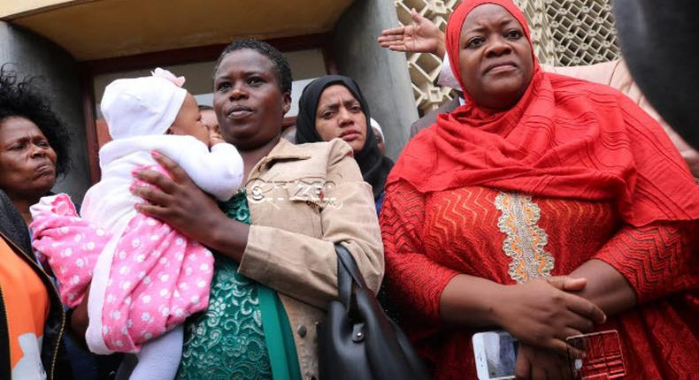 Kwale Woman Rep Zulekha Hassan in red outside Parliament building. (Citizen)