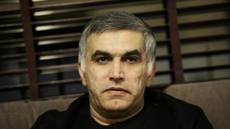 (FILES) In this file photo taken on November 2, 2014 Bahraini human rights activist Nabeel Rajab sits at his home in the village of Bani Jamrah, west of Manama