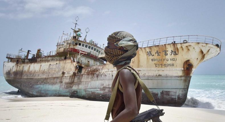 Somali pirate at shore.