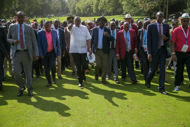 President Uhuru Kenyatta with NASA leader Raila Odinga at the Barclays Kenya Open. The two agreed to use sports to unite the country