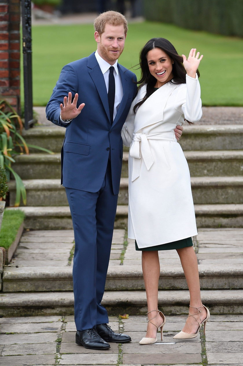 FILE PHOTO: Britain's Prince Harry poses with Meghan Markle in the Sunken Garden of Kensington Palac