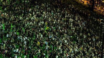 Two dozen Hong Kong activists in court over banned Tiananmen vigil