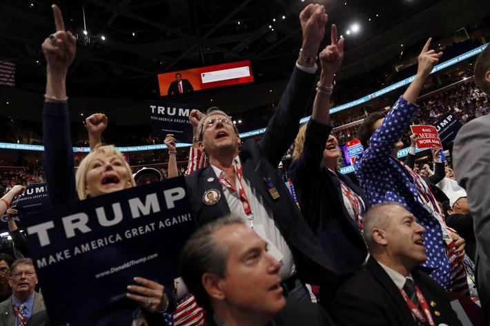 Delegates raise their fists and shout at the Republican National Convention in Cleveland
