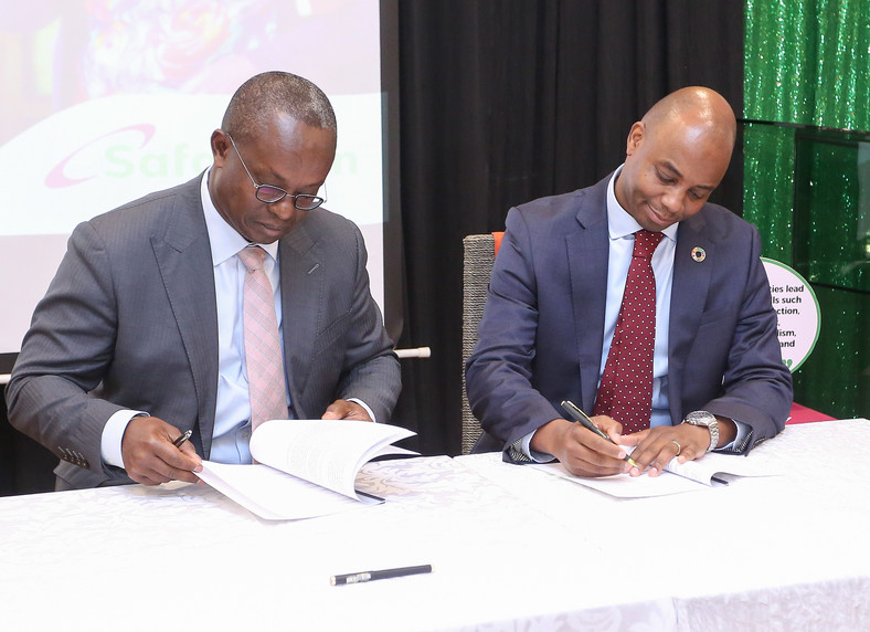 Memorandum of Agreement signing between Safaricom PLC and Kenya ForestServices officiated by Chairman Kenya Forest Services, Peter Kinyua and ChiefCorporate Affairs Officer, Safaricom PLC, Steve Chege.