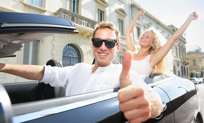 Car driver happy giving thumbs up - driving couple