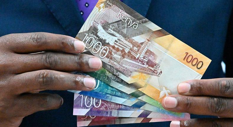 [FILE] Central Bank of Kenya (CBK) governor Patrick Njoroge displays some of the new designs for the Kenyan currency notes in 2019.