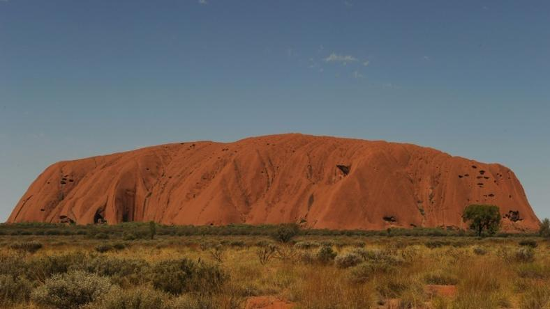 Uluru, formerly known as Ayers Rock, is a a large sandstone rock formation and the world's biggest monolith