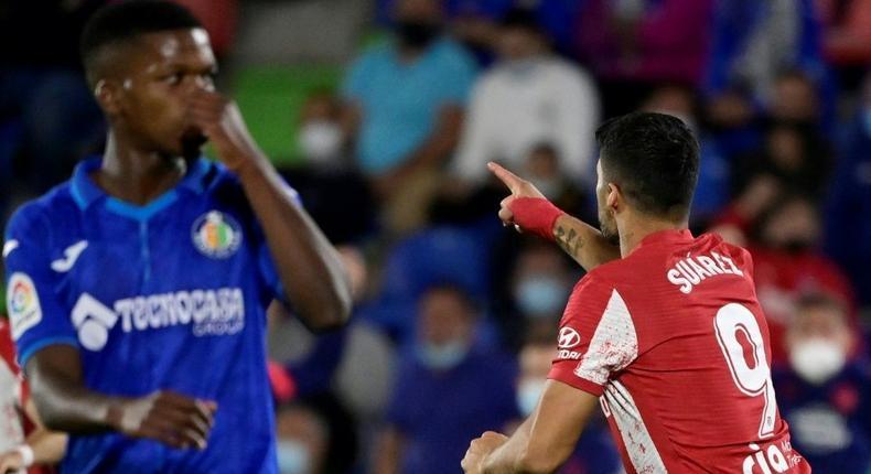 Luis Suarez (R) scored a late double for Atletico Creator: JAVIER SORIANO