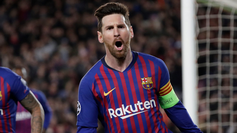Barcelona's Lionel Messi, right, celebrates after scoring his side's third goal during the Champions League round of 16, 2nd leg, soccer match between FC Barcelona and Olympique Lyon at the Camp Nou stadium in Barcelona, Spain, Wednesday, March 13, 2019. (AP Photo/Emilio Morenatti)