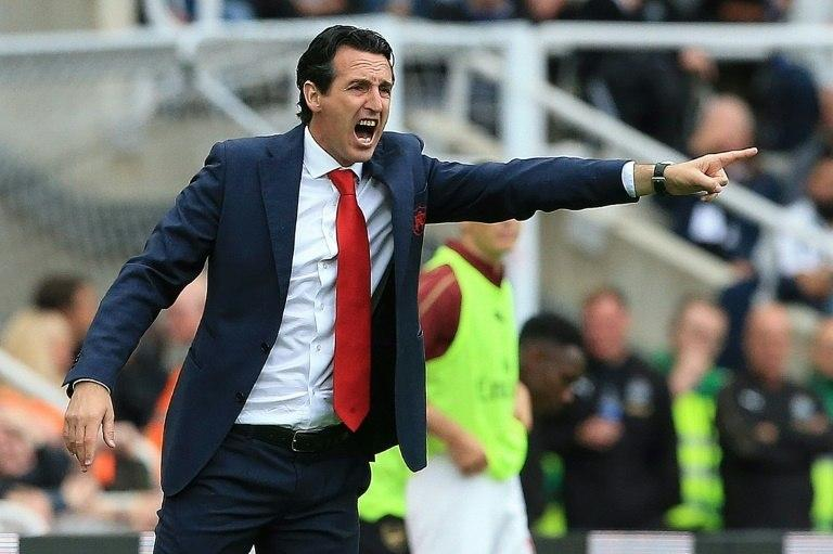 Arsenal coach Unai Emery shouts instructions from the touchline at St James' Park on Saturday