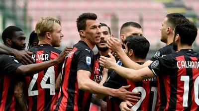 Milan squeuze past Genoa to end home hoodoo