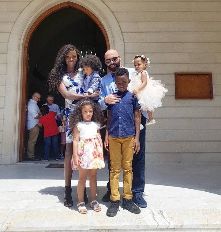 Dorah Mwima with her children and husband