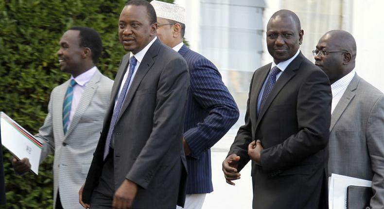 Kenya's President Uhuru Kenyatta (front L) and his Deputy William Ruto (front R) leave the State House after Kenyatta's case at the International Criminal Court (ICC) was dropped, in the capital Nairobi in this December 5, 2014.