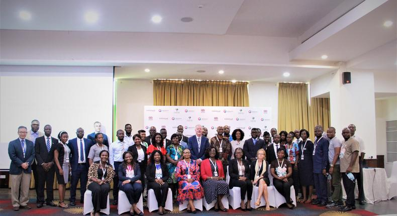 """Participants at the Root of Change Learning Conference: """"Together we innovated and overcame: how we worked with rural women to break down barriers to financial inclusion, 15th September 2021 at the Alisa Hotel, Accra."""