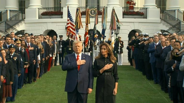 US President and First Lady observe moment of silence for victims of 9/11