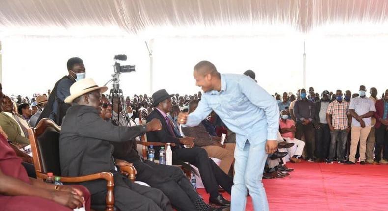 File image of Embakasi East MP Babau Owino sharing a light moment with former Prime Minister Raila Odinga