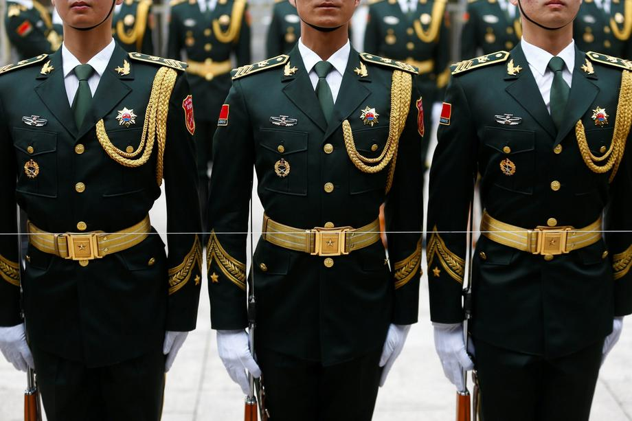 Members of the honour guard prepare for a welcoming ceremony at the Great Hall of the People in Beij