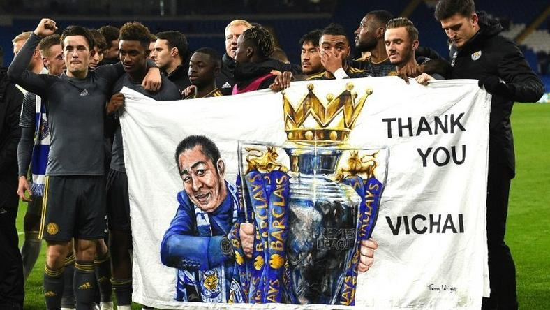 Leicester players hold a banner in honour of late owner Vichai Srivaddhanaprabha after their Premier League win against Cardiff