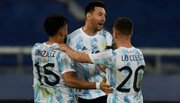 Argentina's Lionel Messi (center) celebrates his goal against Chile at the 2021 Copa America with teammates Nicolas Gonzalez (left) and Giovani Lo Celso Creator: MAURO PIMENTEL