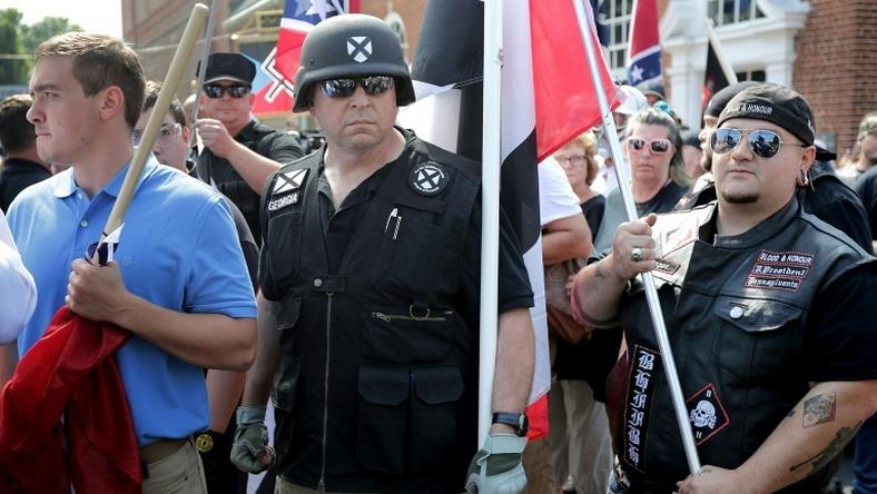 "White nationalists, neo-Nazis and members of the ""alt-right"" march in Charlottesville, Virginia in August 2017"