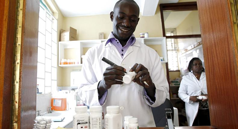 Michael Otieno, a pharmacist, dispenses anti-retroviral (ARV) drugs at the Mater Hospital in Kenya's capital Nairobi