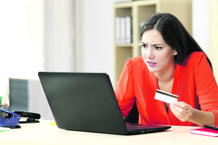 stock-photo-casual-buyer-worried-with-problems-buying-on-line-with-a-credit-card-and-a-laptop-in-a-little-357964961