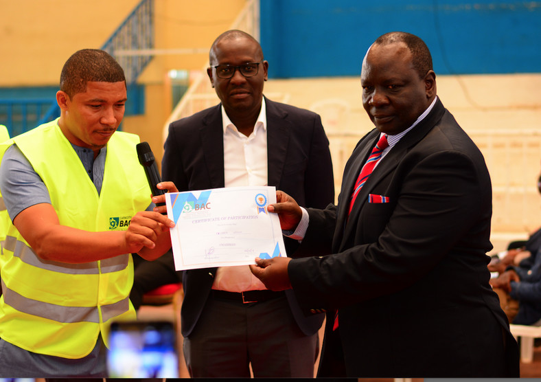 New KPBC chairman Rueben Ndolo receives his certificate from the elections returning officer Brian Weke (L) as outgoing boss Hillary Alila (C) looks on Image: ERICK BARASA.