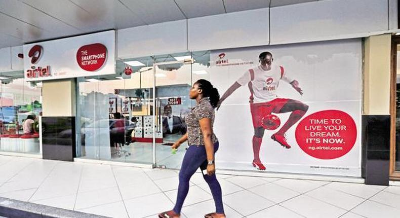 A customer walks pass an Airtel store in Nigeria