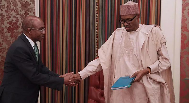 CBN Governor, Mr. Godwin Emefiele and President Buhari during recently meeting.