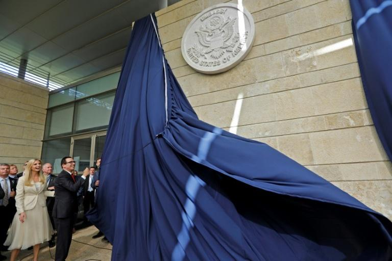 US Treasury Secretary Steve Mnuchin and Ivanka Trump (L) unveil an inauguration plaque during the opening of the US embassy in Jerusalem on May 14, 2018