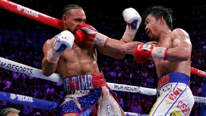 Filipino boxer Manny Pacquiao slams a right to the face of American Keith Thurman