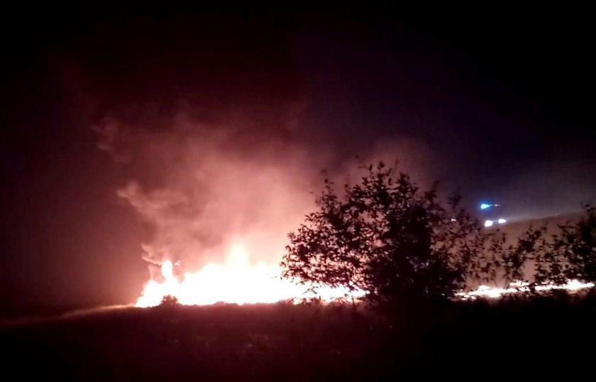 A plume of smoke rises from flames after an Utair Boeing 737 passenger plane made a rough landing an