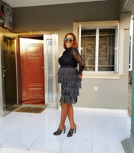A beautiful frilly dress on style influencer, Yomi