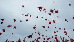 Students toss their hats at Wesleyan University's commencement ceremony in 2018.