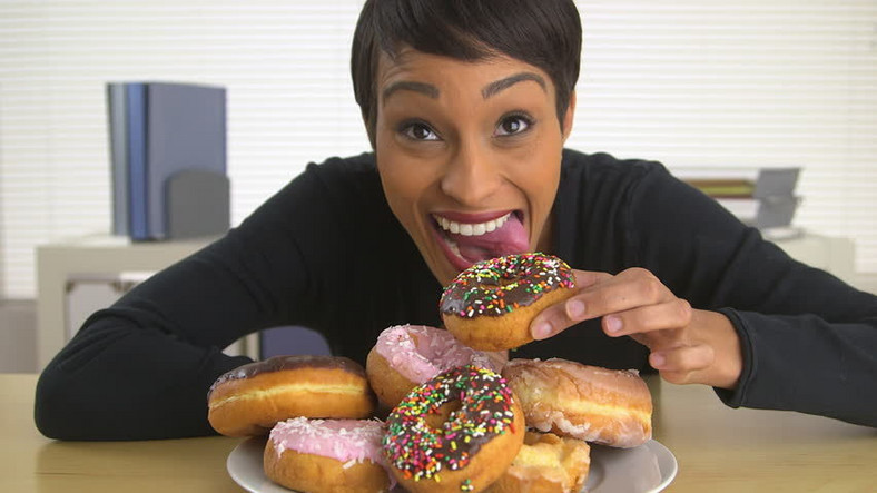 Woman eating doughnut(shutterstock)