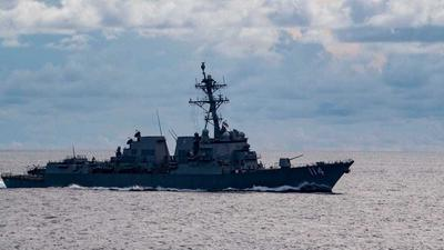 US Navy warship challenges China in South China Sea after US blasts Beijing's 'unlawful' claims and 'gangster tactics'
