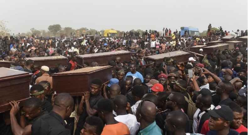 Pallbearers carry coffins during the funeral service for people killed during clashes between cattle herders and farmers, on January 11, 2018, in Ibrahim Babangida Square in the Benue state capital Makurdi.