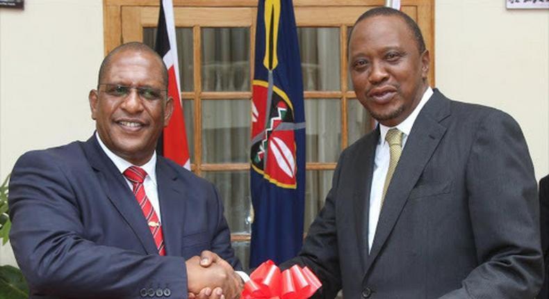 President Uhuru Kenyatta (right) and Environment CS Keriako Tobiko