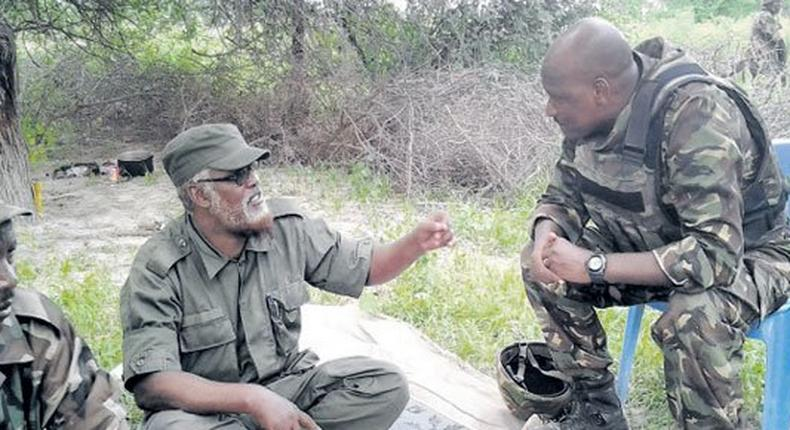 A file photo of Sheikh Ahmed Mohamed Madobe (C)  who is the President of Jubaland region, in a conversation with a KDF soldier