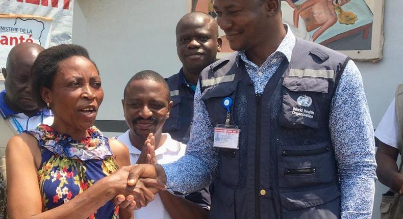 WHO Field Coordinator in Beni Dr Keïta, congratulates the last patient to leave the Ebola treatment centre, Masiko Muhaso