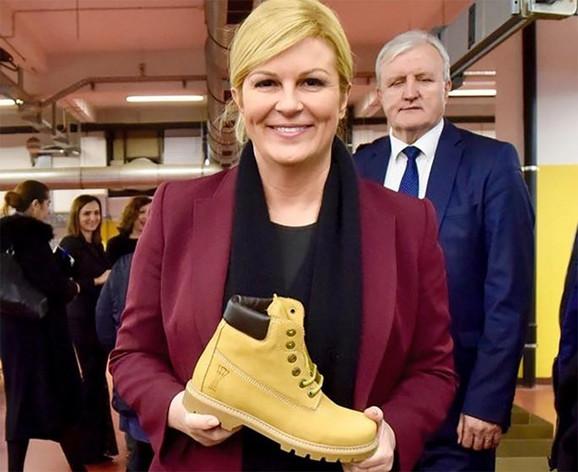 Kolinda Grabar Kitarović sa žutim zengama