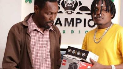 Omosh finally receives camera, tripod & microphone from singer B-Classic (Photos)