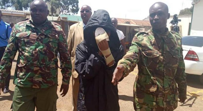 Naftali Njahi Kinuthia escorted by police to his first court appearance following murder of Ivy Wangechi (Twitter)