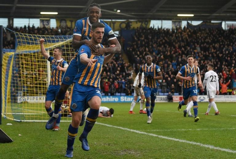 Shrewsbury's Luke Waterfall (centre) thought he had sealed a famous upset over Wolves