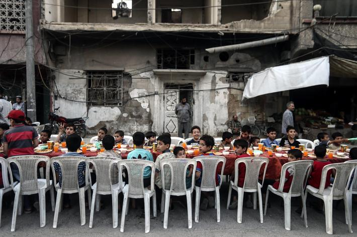 Iftar on a destroyed street in Douma