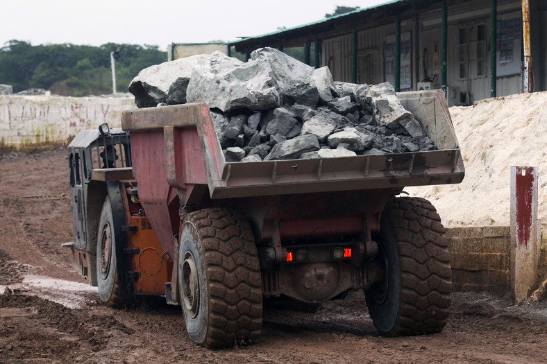 A truck exits the mine after collecting ore from 516 metres below the surface at the Chibuluma copper mine in the Zambian copperbelt region, January 17, 2015.