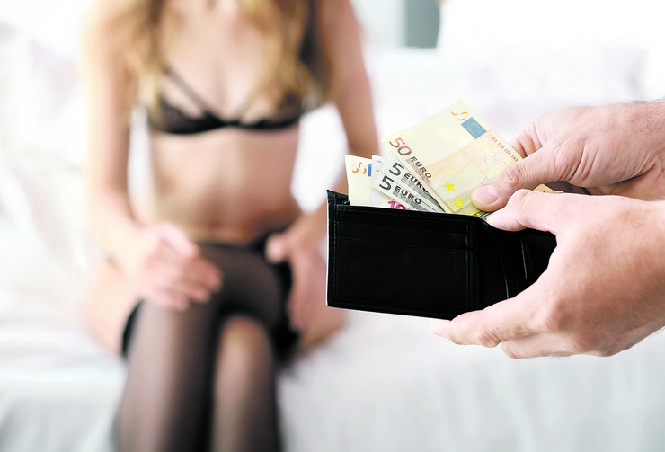 stock-photo-client-paying-prostitute-for-her-work-in-brothel-1176148060