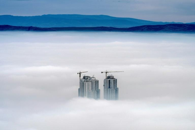 Some of the highest buildings in the Skopje area peak above the clouds in an area where the air pollution can practically paralyse the Macedonian capital