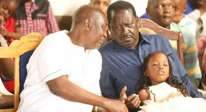 ODM party leader Raila Odinga speaks with hie elder brother Oburu Odinga at a past public event